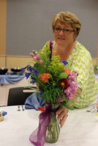 Board member, Pean Frey, created the flower centerpieces for the luncheon.